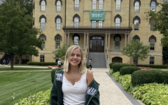 Emerson Peters stands hopeful in front of the Main Building at the University of Notre Dame during her prospective student visit.