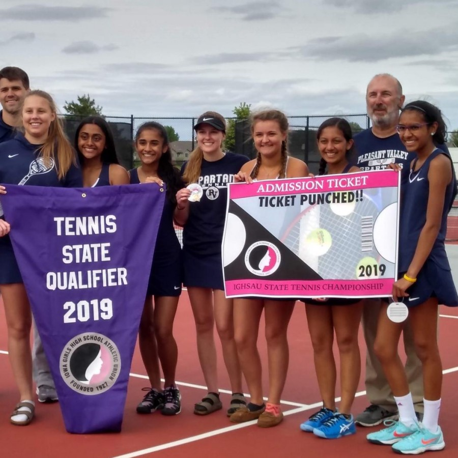 The 2018-2019 varsity girls tennis team celebrates after beating rivals Bettendorf 5-0, securing their placement at the state competition. Pictured is (back row, left to right)  Brett Ahlgren, Eric Crawford, (front row, left to right) Julia Hillman, Bel Goedert, Sakshi Lawande, Eesha Lawande, Kayla Nutt, Lauren Hird, Aabha Joshi and Ramya Subramaniam.