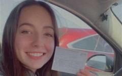 Morgan Sorenson, a PV high school senior, holding her COVID vaccine card.