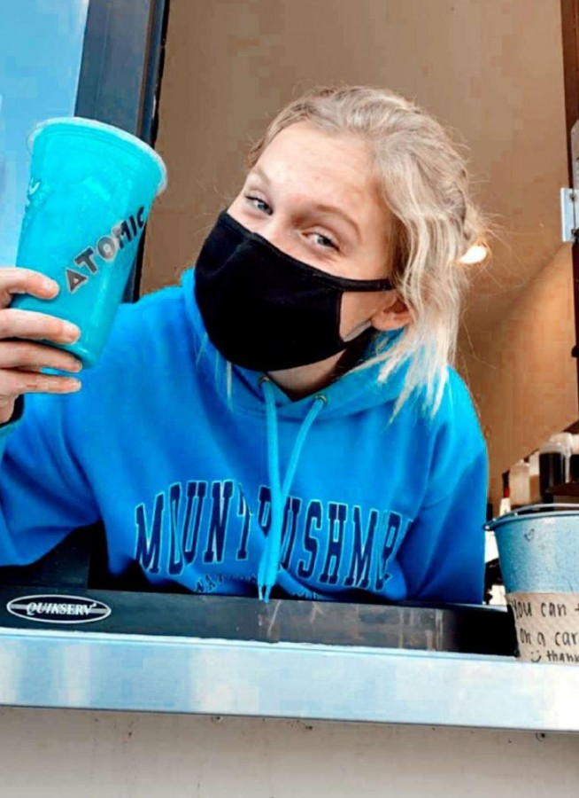 Isabel Russman pictured working at Atomic Coffee Bar during the hybrid model of school this fall.