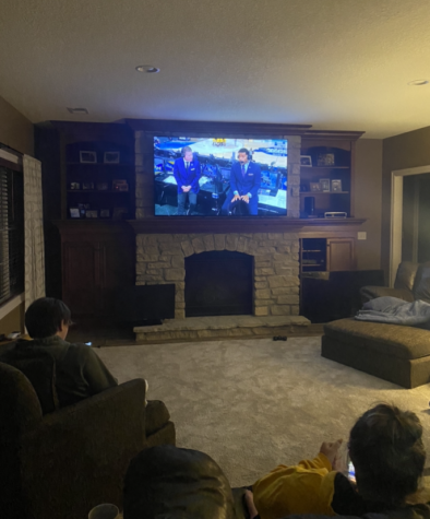College student Creighton Clausen and senior Lily Barrett watch the NCAA tournament during the sweet 16 round.