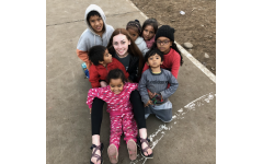 Emma Cramer is surrounded by the joyful Peruvian kids whom she visited in the Summer of 2019.