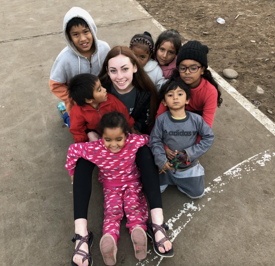 Emma+Cramer+is+surrounded+by+the+joyful+Peruvian+kids+whom+she+visited+in+the+Summer+of+2019.