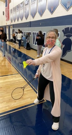Aimee Peters playing badminton during her prep period to spend more time with her students.