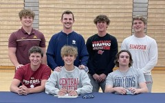 Coach Derek Stecklein proudly stands with seniors from PVs  baseball team who have committed to play at the collegiate level.