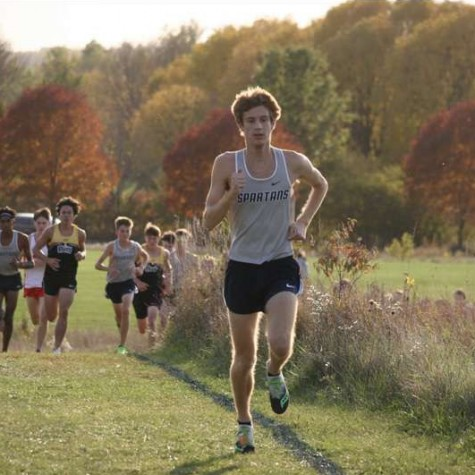 Senior Kole Sommer runs in a cross country meet for the Pleasant Valley Spartans.