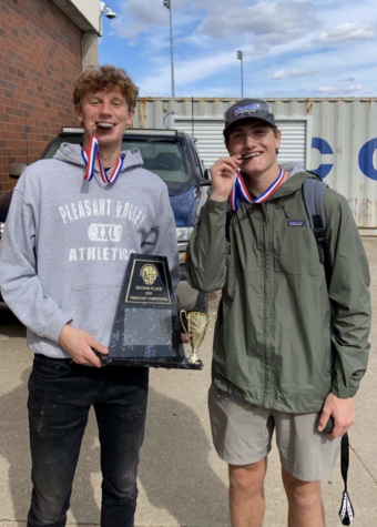 Seniors Kole Sommer and Alex Melvin show off their silver medals after winning second place at the local trebuchet competition held at Bettendorf High School.