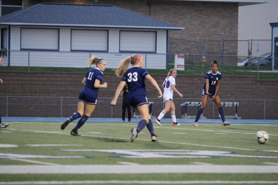 Sisters Isabel and Morgan Russmann playing together at Pleasant Valley High School Spartan Stadium. The sisters have proved to be a dynamic duo as they assist the Spartans in an undefeated season and pursue a state championship.