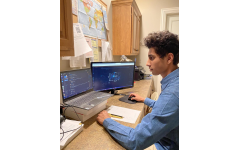 Junior Vinay Joshi working on his business, AIOResailors through the software CyberAIO