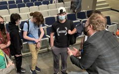 """Pleasant Valley chamber choir students gather around composer, Dr. Eric Barnum, to ask questions regarding his career and to gain perspective on the meaning behind his choral piece, """"The Sounding Sea."""""""