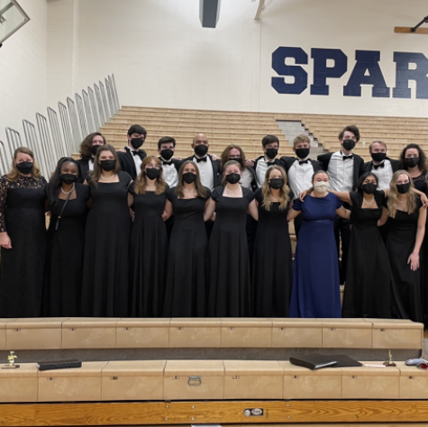 Senior choir members stand with their choral directors and pianist at their final concert of the 2020-2021 school year.