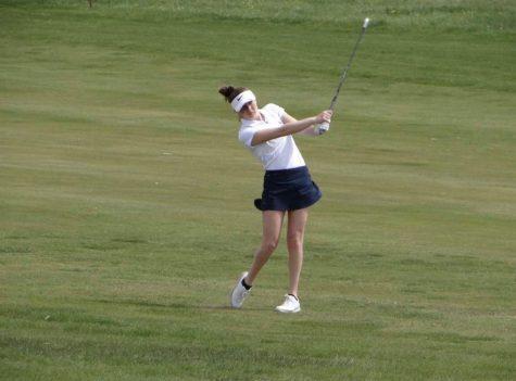 Junior Erika Holmberg at a golf tournament after missing her last golf season.