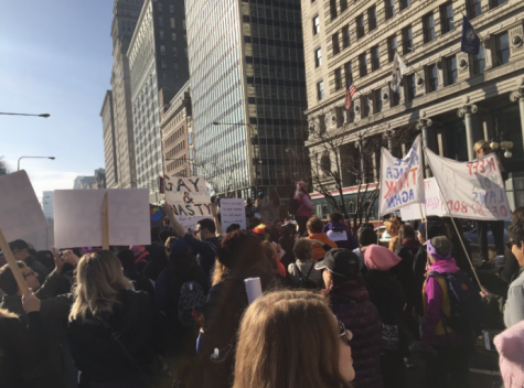 People flood the streets to protest in the 2017 Women's March in Chicago, Ill.
