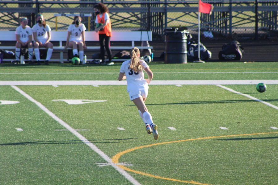 Morgan Russmann playing in a soccer game at Bettendorf High School