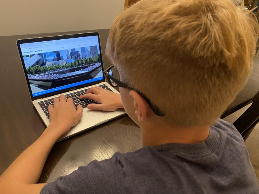 8th grade student Zach Zuiderveen looks at the official 9/11 Memorial & Museum Website after learning about it in Mrs. Hall's class.