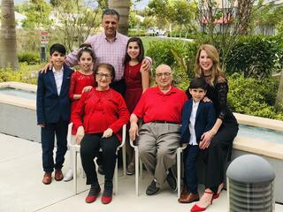 A photo of Rahila Amany, an Afghan refugee from Kabul, and her family. She has four grandchildren who attend PV and a scholarship for her loving nature.