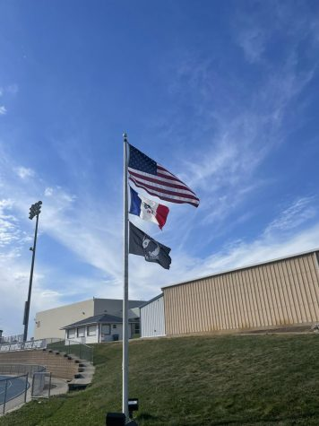 The American flag is seen flying in front of Pleasant Valley High School on a Sunday evening.