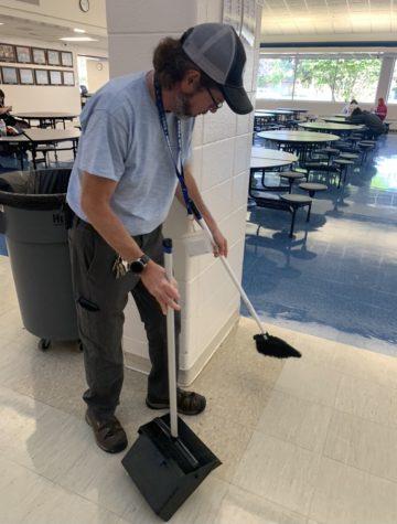 Head custodian Dave Wheeler helps manage a clean cafeteria despite recent short staffing.