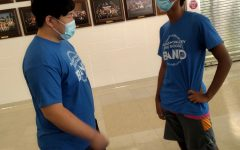 Junior Tejus Kanathur (right) interacts with junior Jun Oh (left) while wearing a mask.