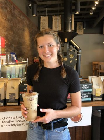 Pleasant Valley senior and Dunn Brothers employee, Erika Holmberg, holds a classic fall drink: the old fashioned latte.