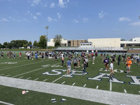 10th-12th grade marching band students practice their newly learned drills and music for the upcoming football game.