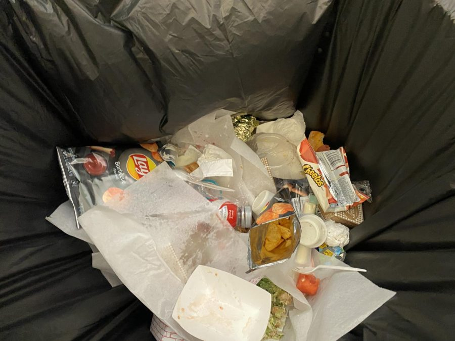 Students throw away a large amount of food on their trays, but it gets covered up by the plastic sheets that are used for pizza day.
