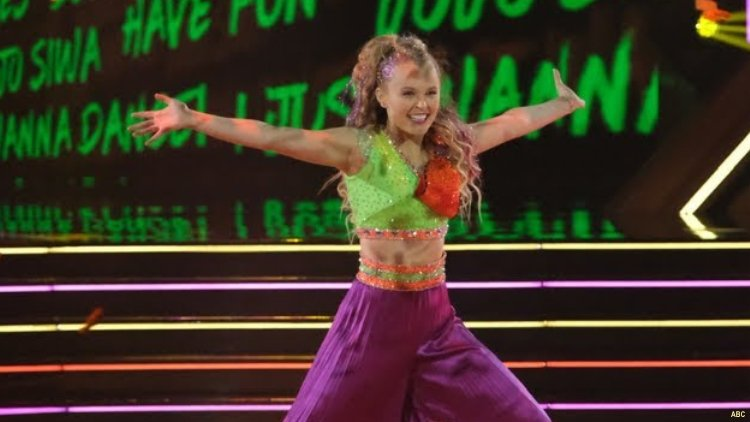 JoJo Siwa performs in her highly anticipated first performance on ABCs Dancing with the Stars. She and her partner, Jenna Johnson became the shows first same-sex dancing couple.