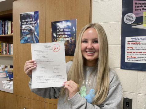 Straight-A student senior Jillian Keppy proudly displays her exemplary grade.
