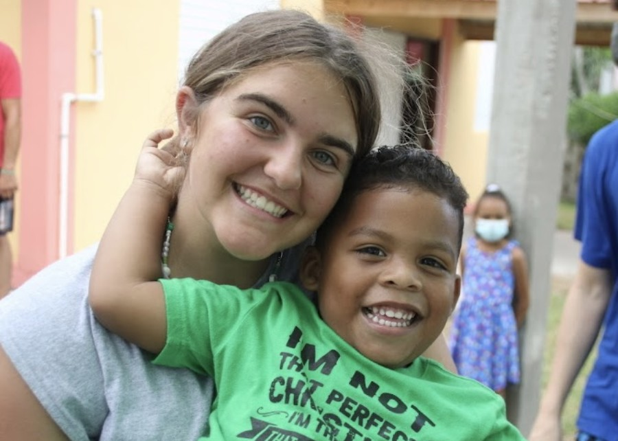 Senior Lily Dumas smiles with a student she met while serving on a mission trip in Belize.