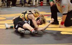 Ella Schmit pins her opponent in a high school match during her junior season campaign.