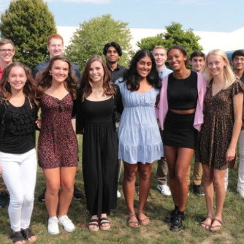 Pleasant Valley's 14 National Merit semifinalists from the class of 2022 pose for a photo in front of Pleasant Valley High School.