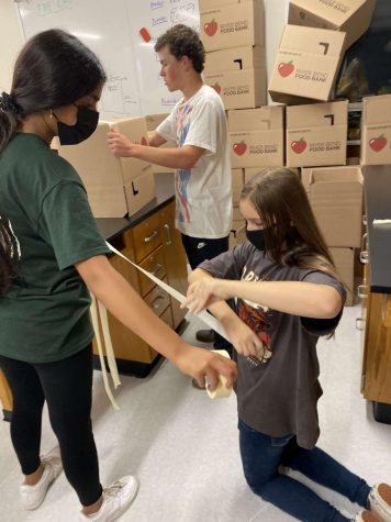 Members of the Spartan Assembly help organize the Student Hunger Drive.